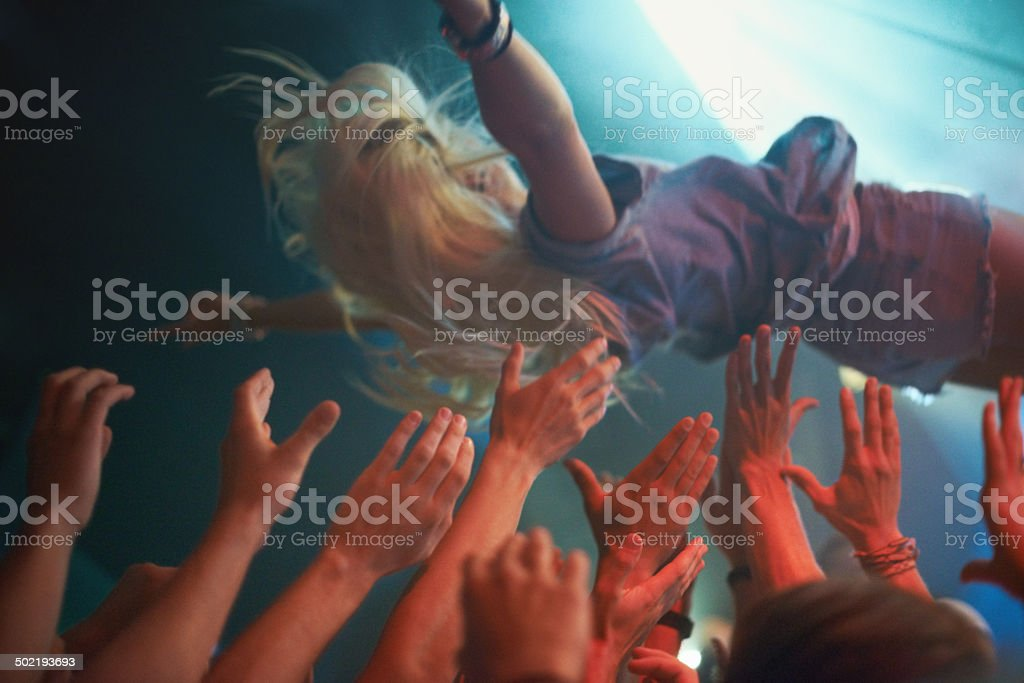 Diving into the crowd! stock photo