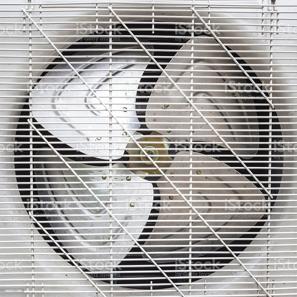 Fan under white plastic grate on metal plate stock photo