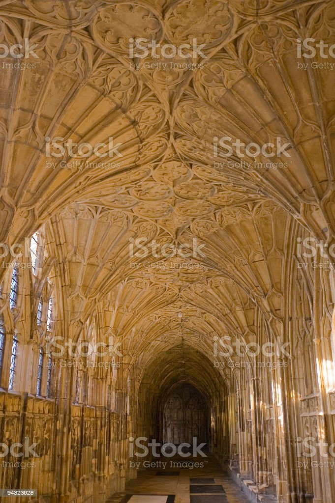 Fan vaulting in quiet stone cloisters stock photo