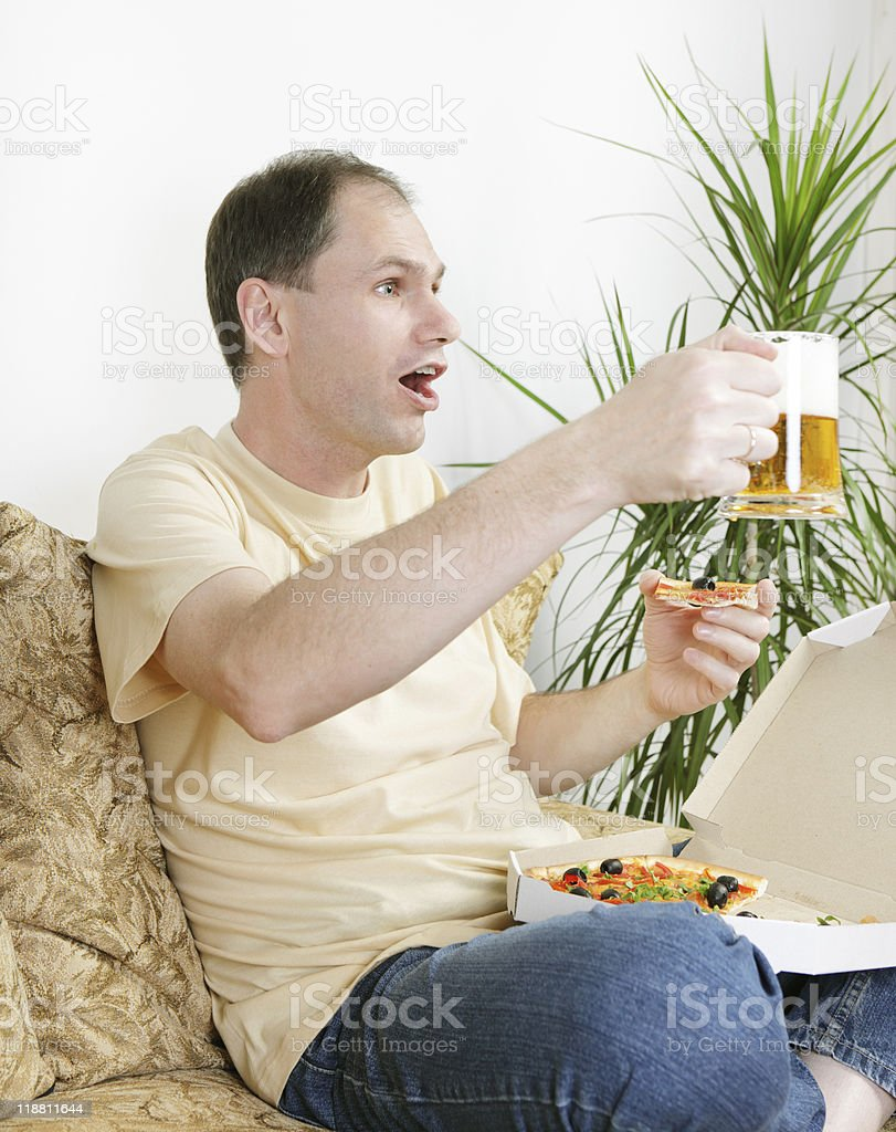Fan with beer and pizza royalty-free stock photo