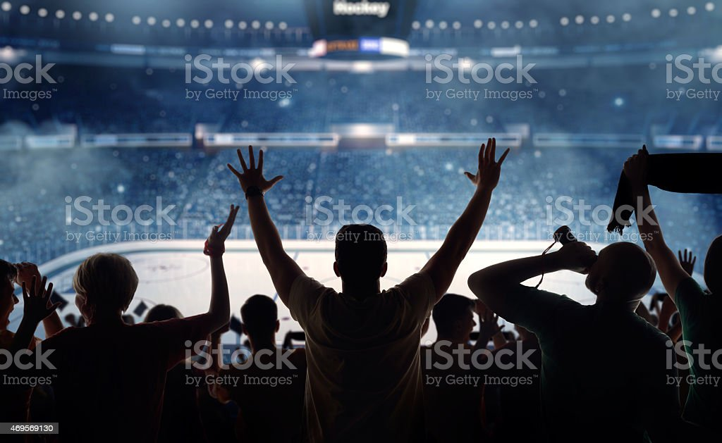 Fanatical hockey fans at a stadium stock photo