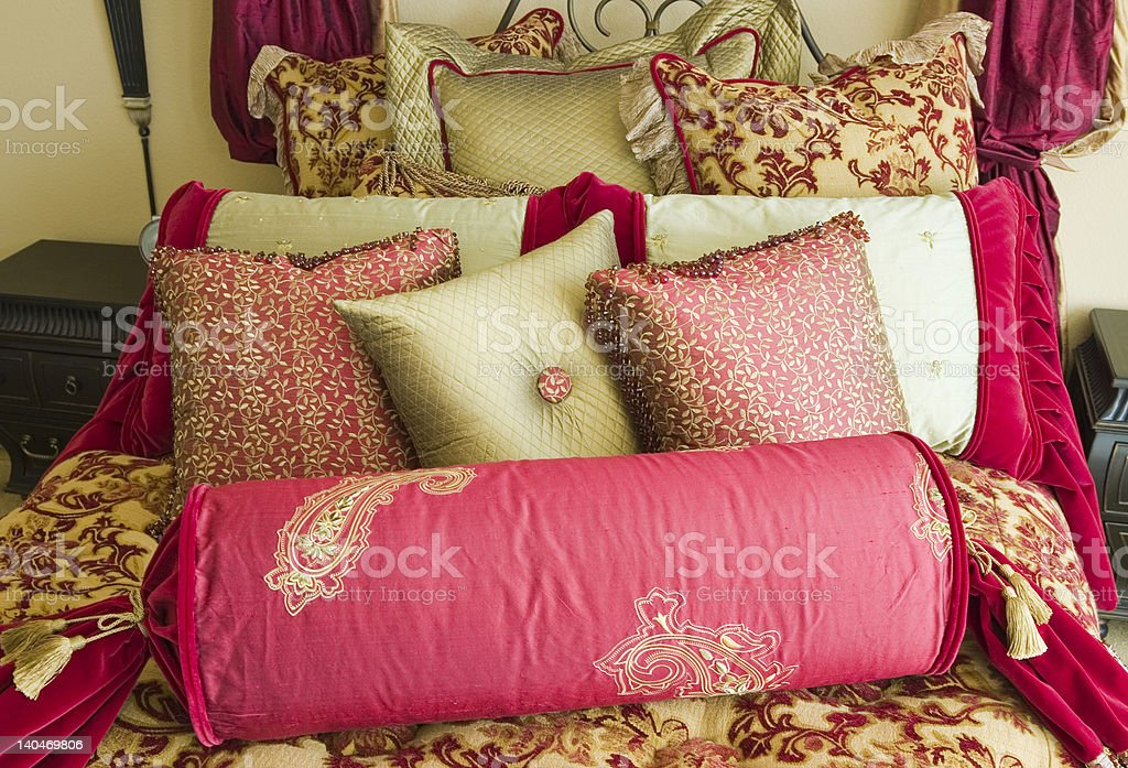 A beautiful custom bedding set in rich hues of reds and golds....