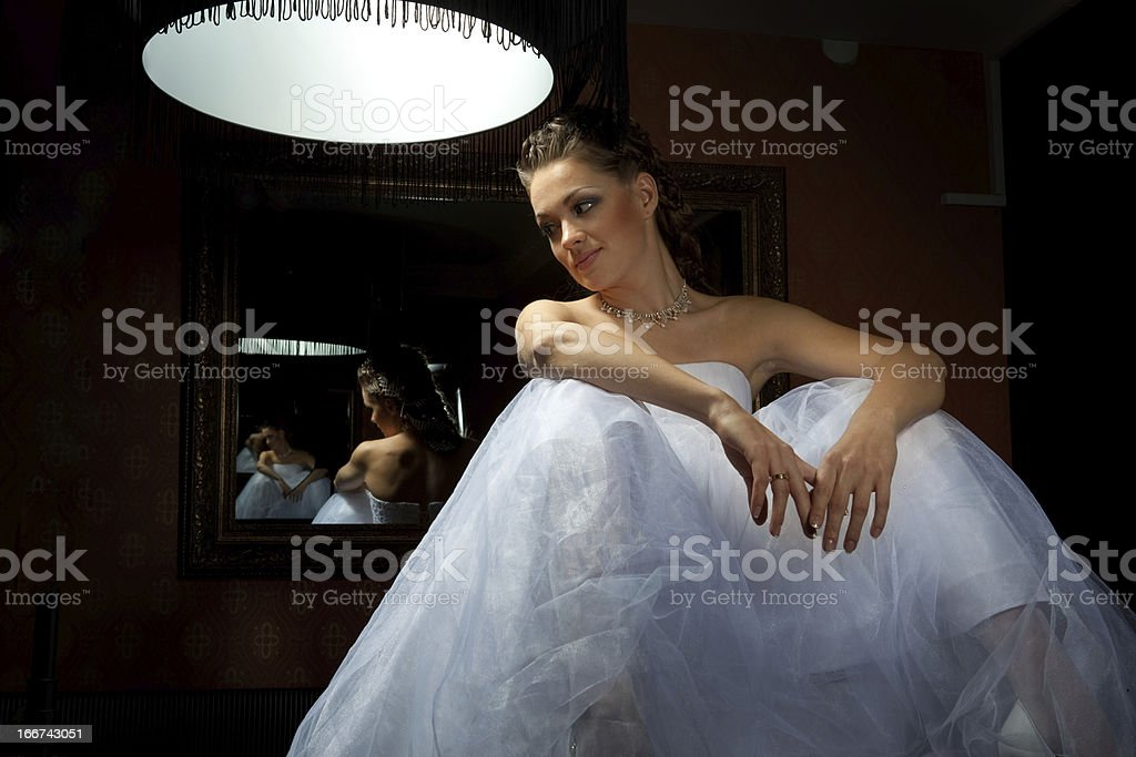 Fancy Bride Sitting under the Lamp. royalty-free stock photo
