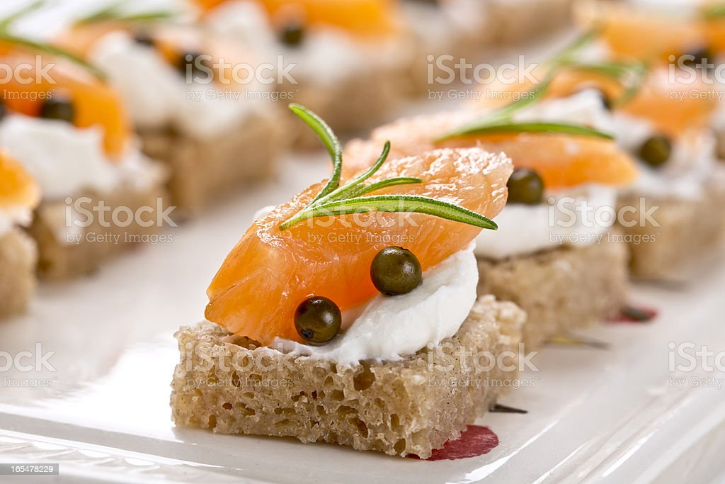 Fancy canapes with salmon and cream cheese stock photo