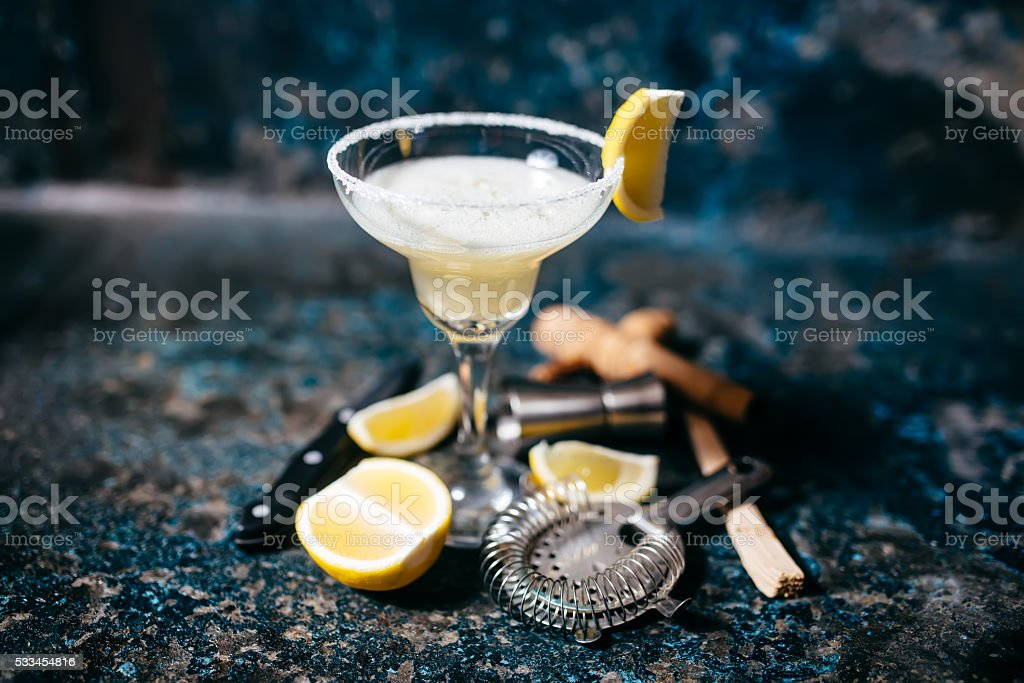 Fancy cocktail with lemons and vodka. Margarita refreshment drink and...