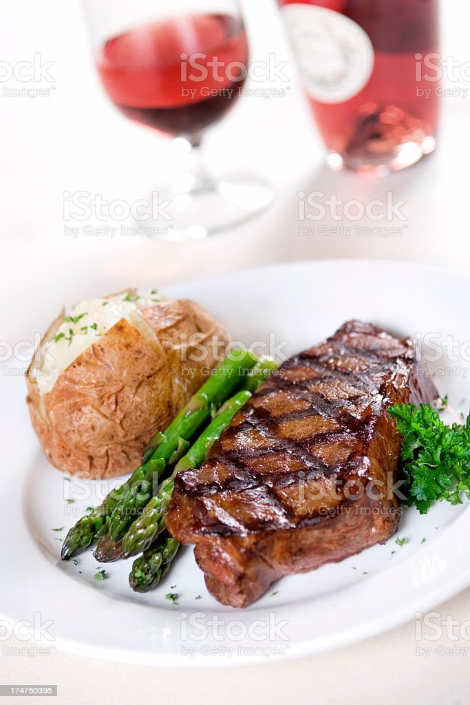 A fancy dinner of steak and wine stock photo