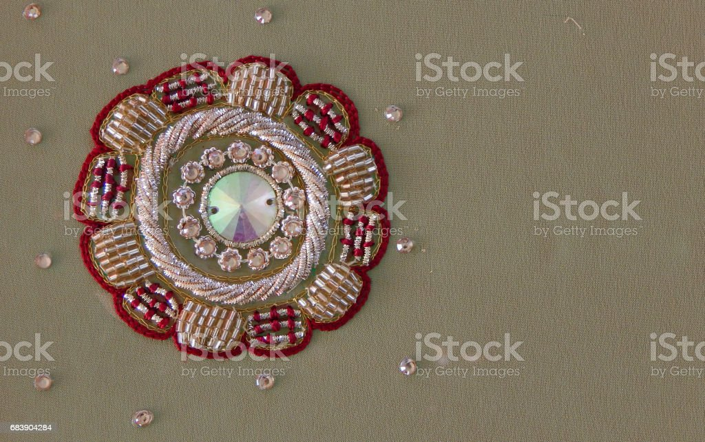 Fancy Embroidery  work on textile background stock photo