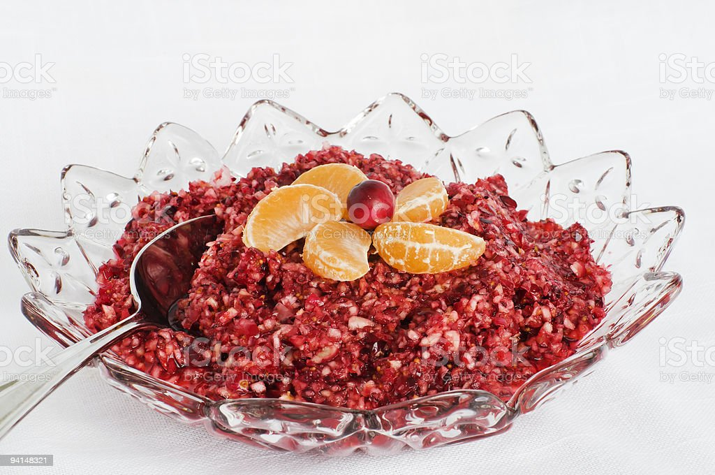 Fancy glass bowl of cranberry sauce with other fruit on top stock photo