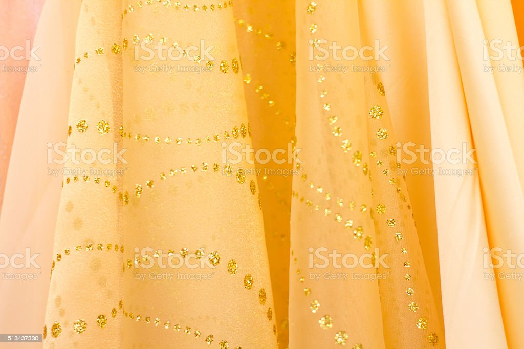 Fancy Glittery Yellow Fabrics Lined Up (Close-Up) stock photo