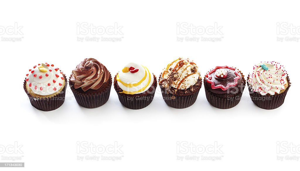 Fancy Gourmet Cupcakes, Dessert Temptations in Row on White Backround stock photo