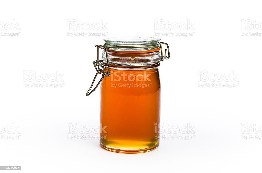 Fancy jar of golden honey royalty-free stock photo