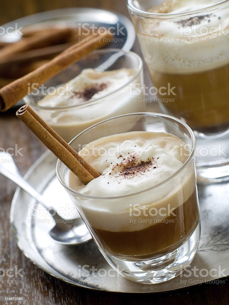 A fancy latte with a cinnamon stick royalty-free stock photo