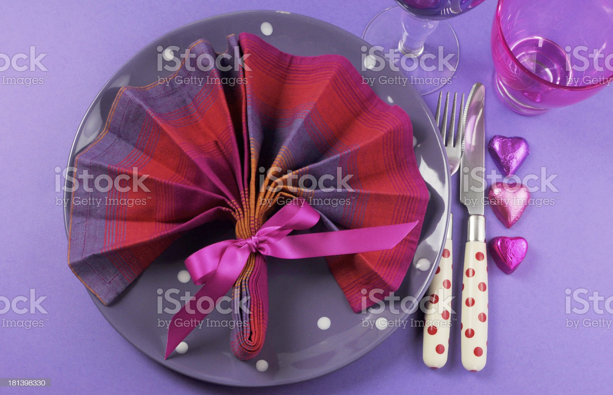 Fancy pink and purple table setting with fan shape napkin royalty-free stock photo