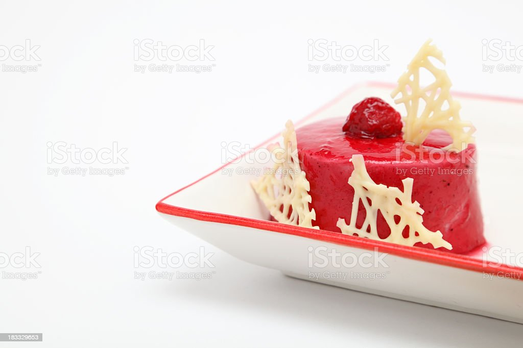 Fancy raspberry mousse dessert on square plate stock photo