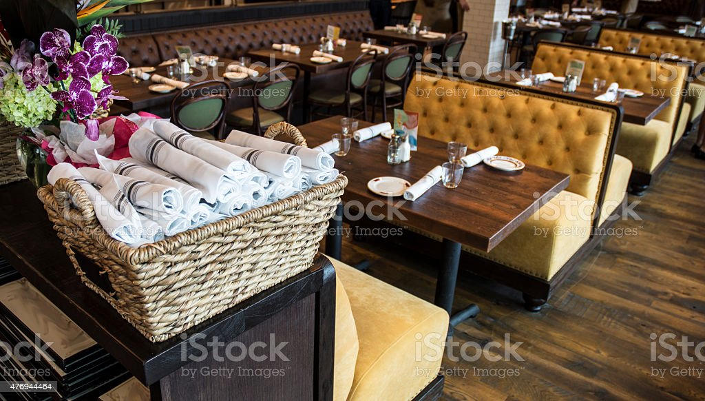 Fancy Restaurant Dining Area With Orchids And Wood Floors stock photo