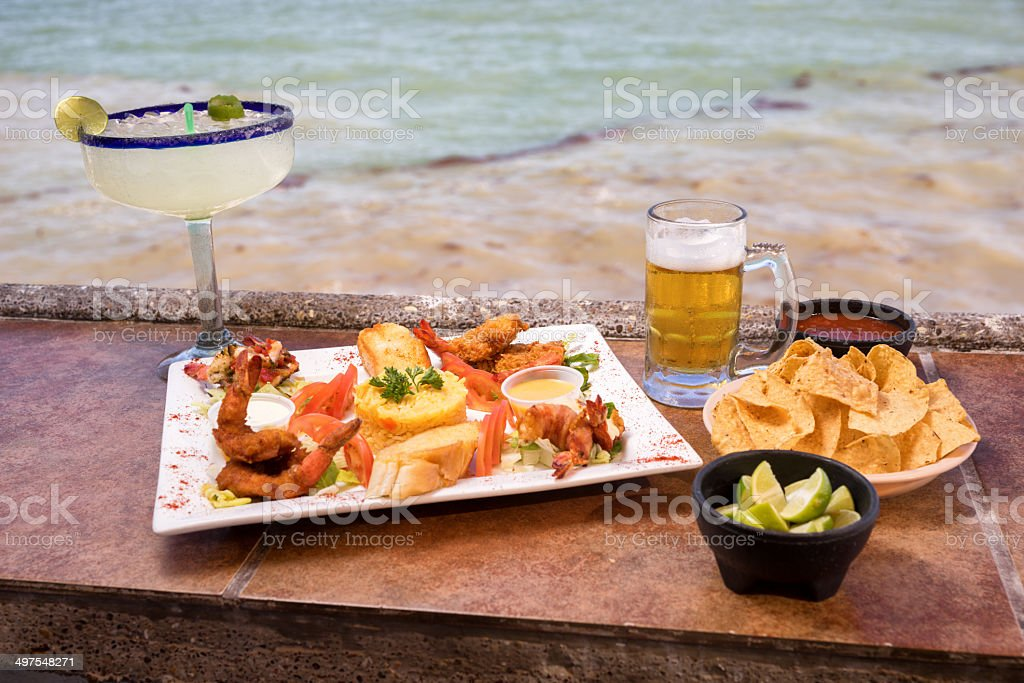 Fancy Shrimp Dinner with Beer and Margarita royalty-free stock photo
