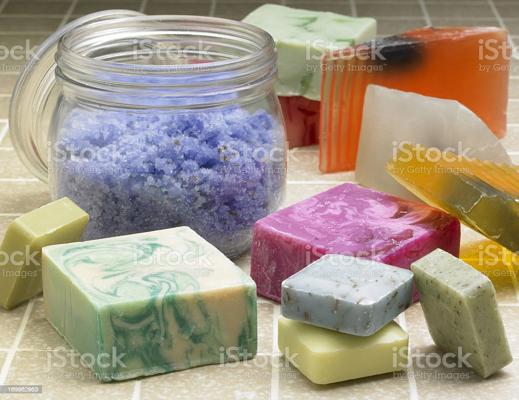 Fancy soaps and bath crystals on tile background royalty-free stock photo