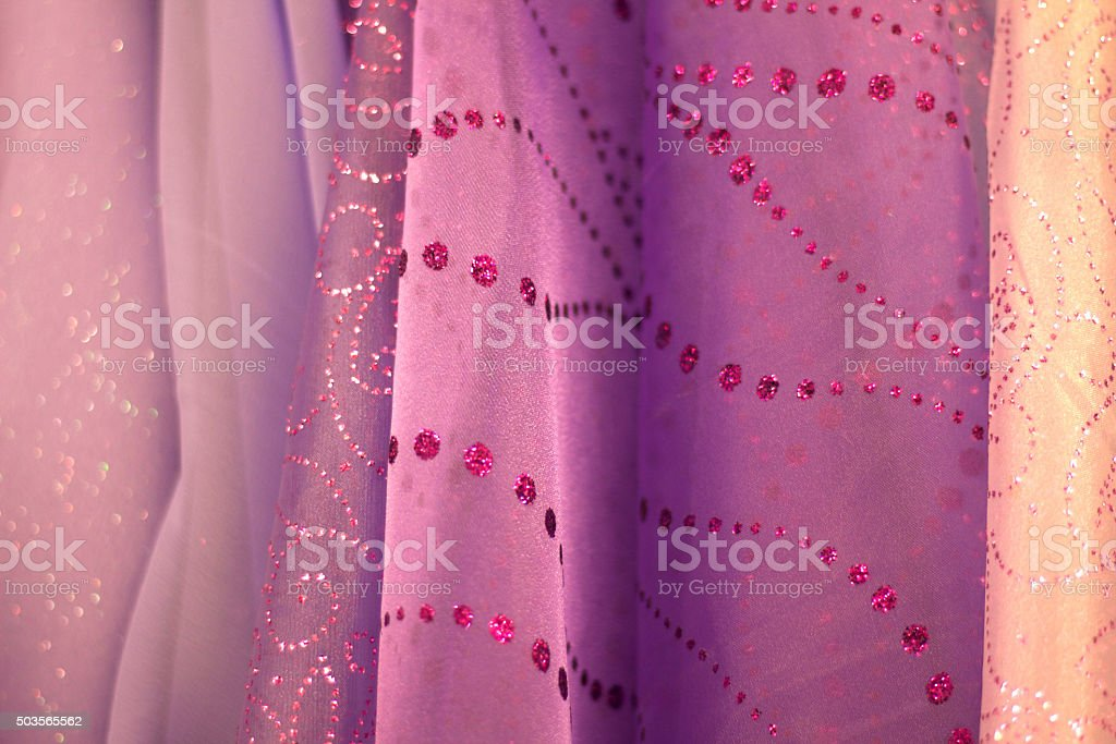 Fancy Sparkly Pink and Purple Indian Fabrics Lined Up (Close-Up) stock photo