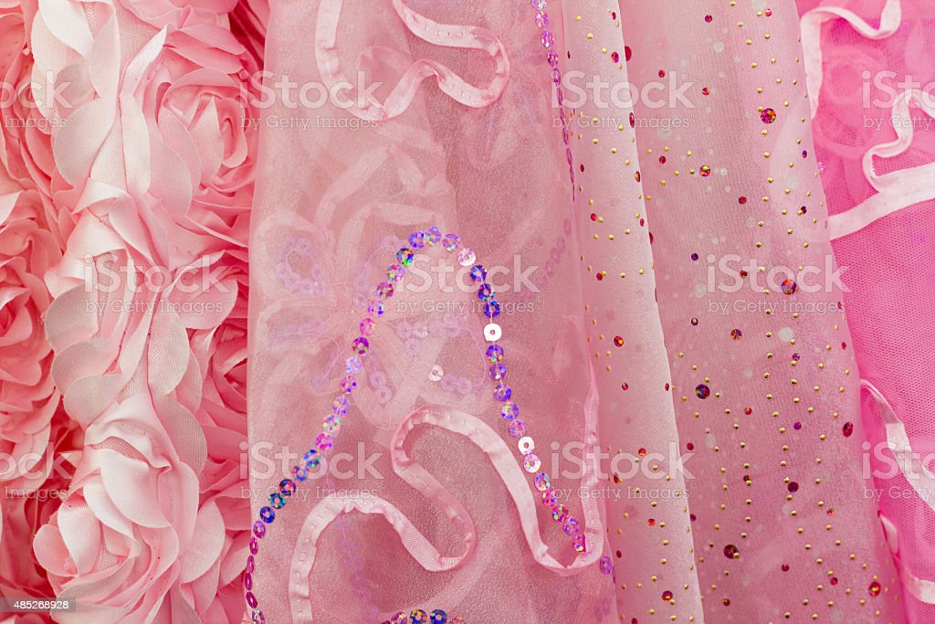 Fancy Sparkly Pink Textured Indian Fabrics Lined Up stock photo