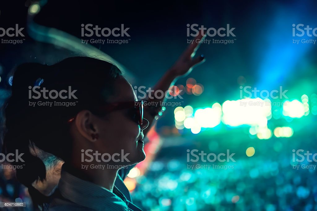 fancy woman enjoying festival, dancing and making hand gestures stock photo
