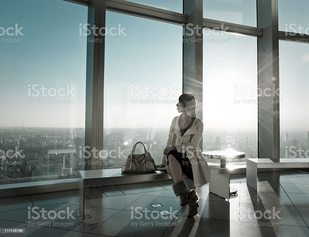 Fancy Woman in Backlight Modern Architecture stock photo