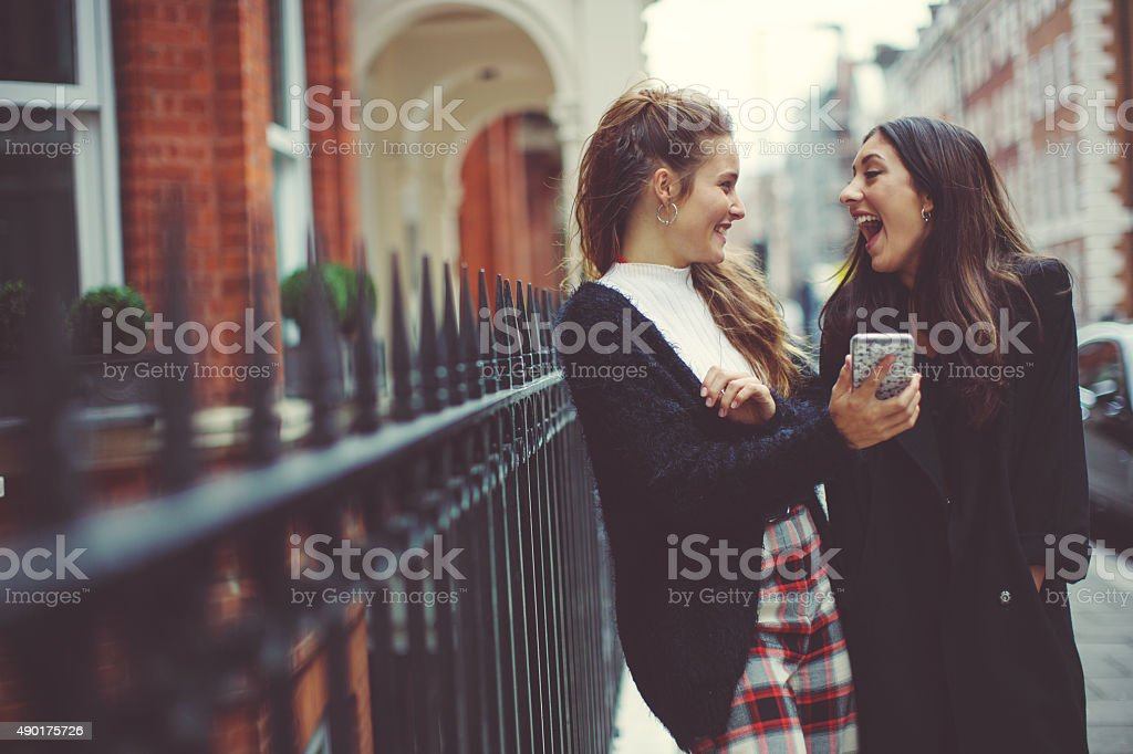 Fancy women in London using a mobile phone stock photo