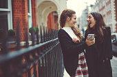 Fancy women in London using a mobile phone
