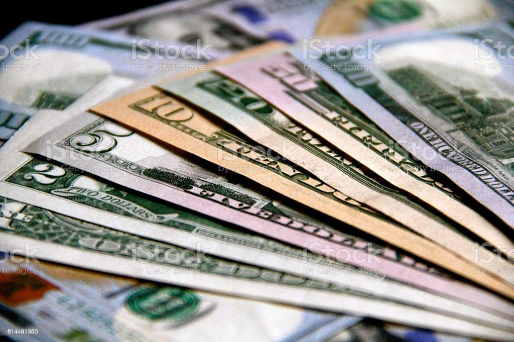 Fanned Out Money Backs Horizontal stock photo