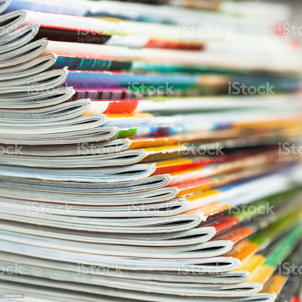 fanned out stack of magazines stock photo