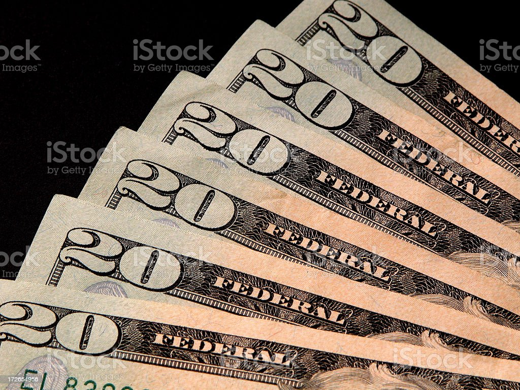 Fanned US $20 Bills On Black stock photo
