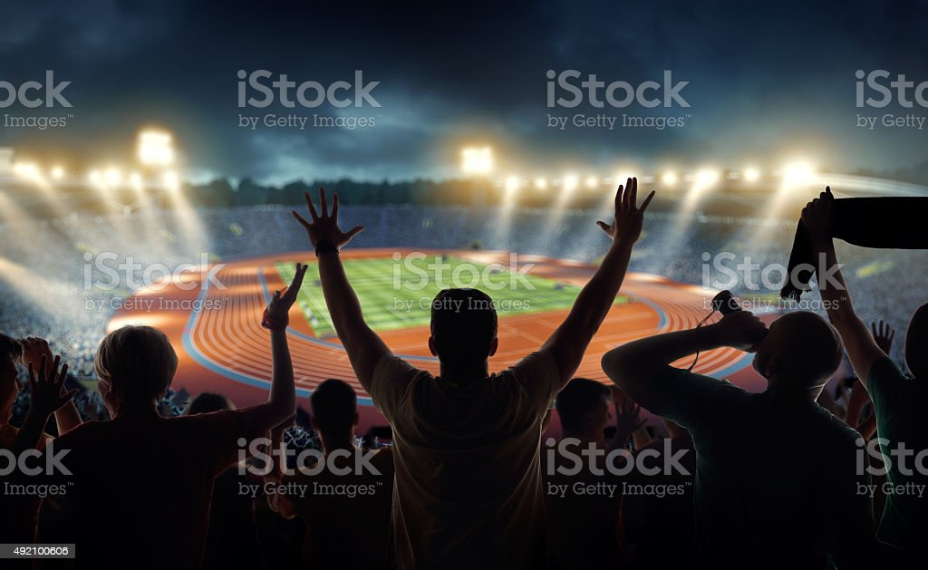 Fans at olympic stadium with running tracks stock photo