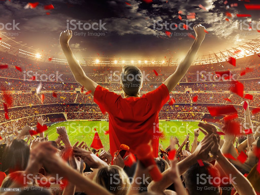 Fans at stadium stock photo