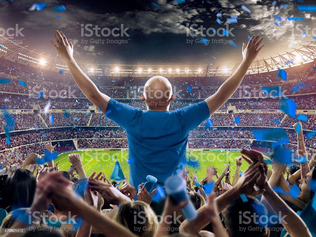 Fans at stadium stock photo