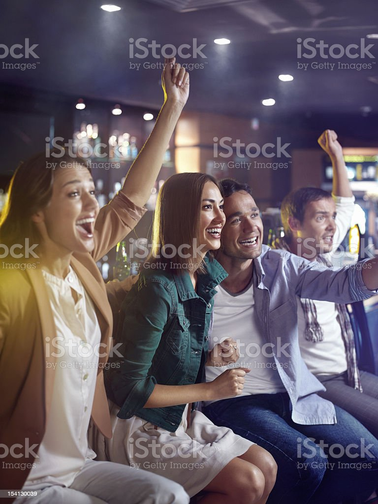 Fans at the bar royalty-free stock photo