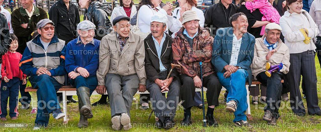 Fans at the competition power of national celebration 'Ysyakh' stock photo
