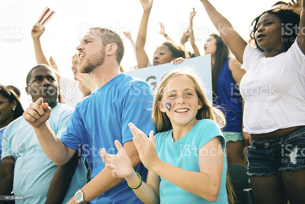 Fans cheer on sporting event stock photo