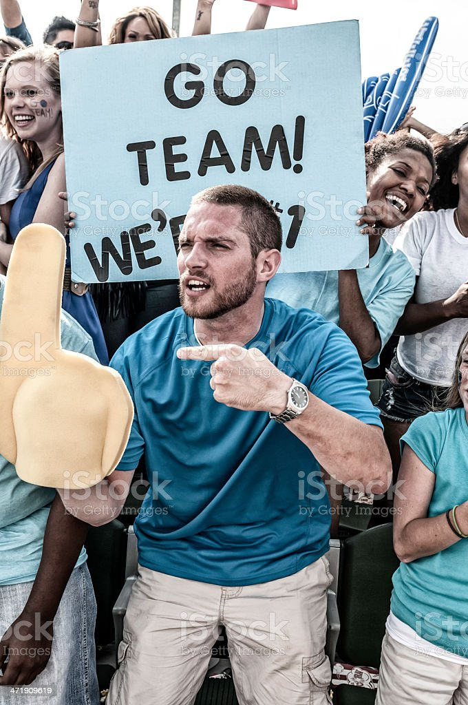 Fans cheering for their team royalty-free stock photo