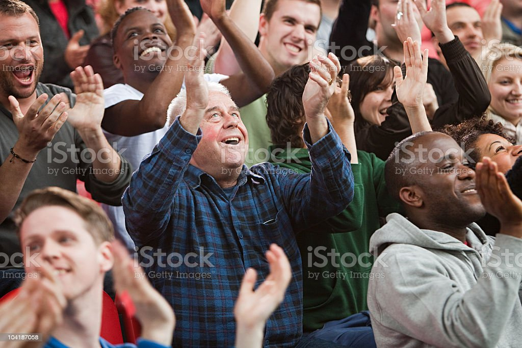 Fans cheering stock photo