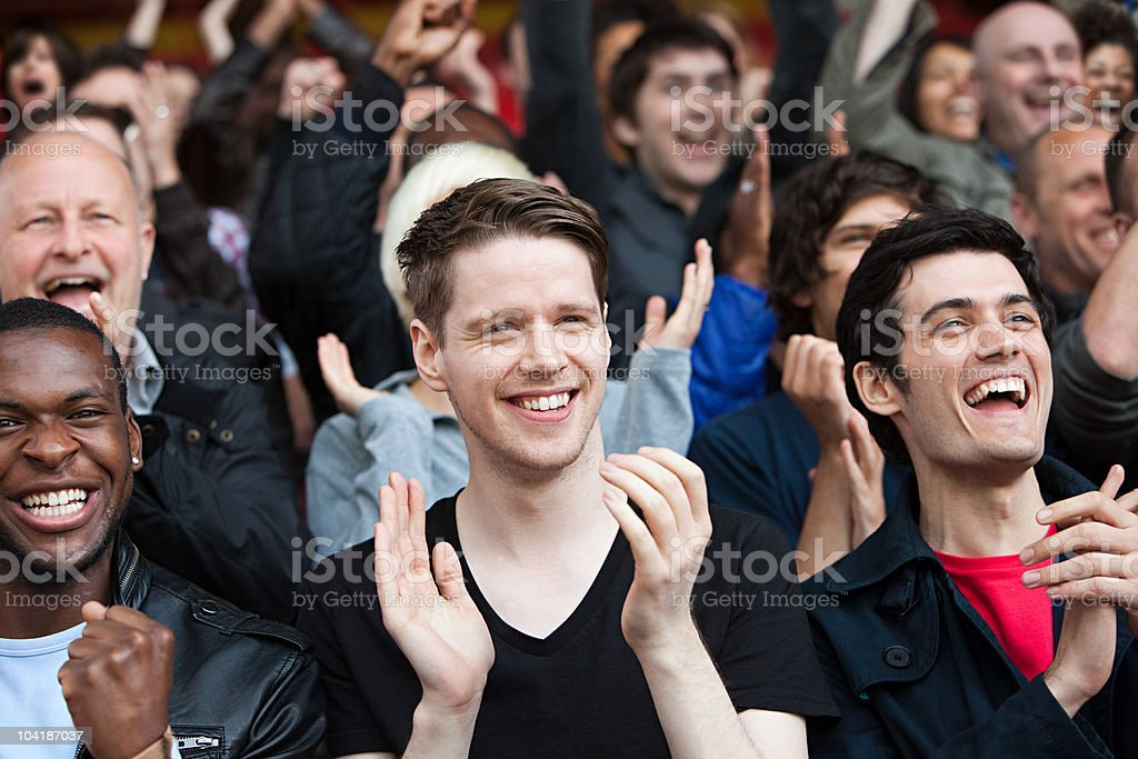 Fans clapping at football match royalty-free stock photo