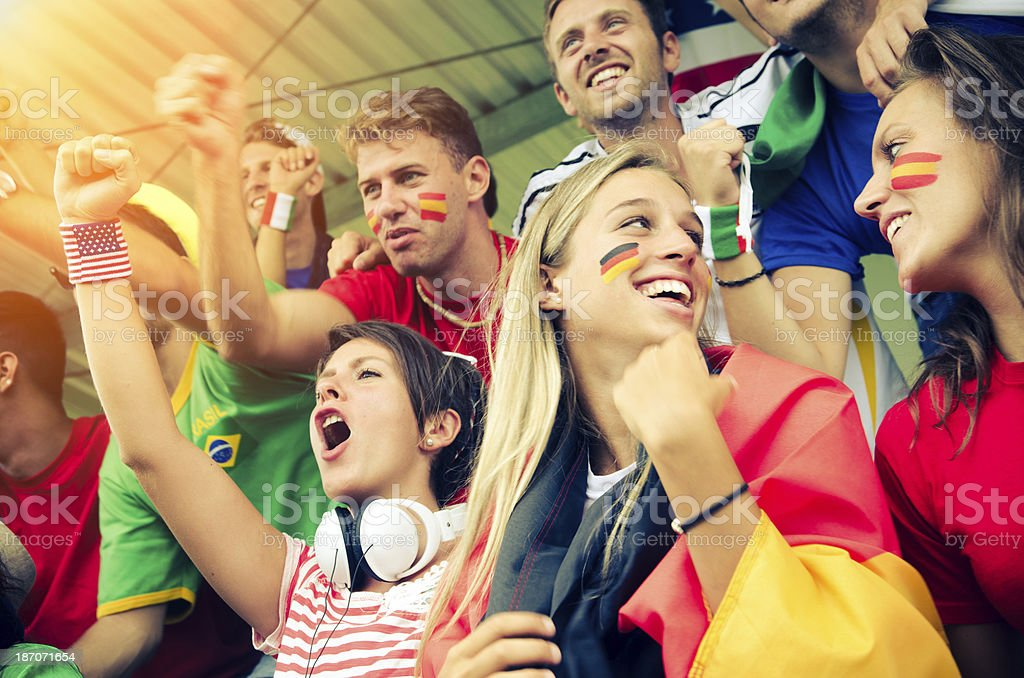 Fans of different nations at the stadium together royalty-free stock photo