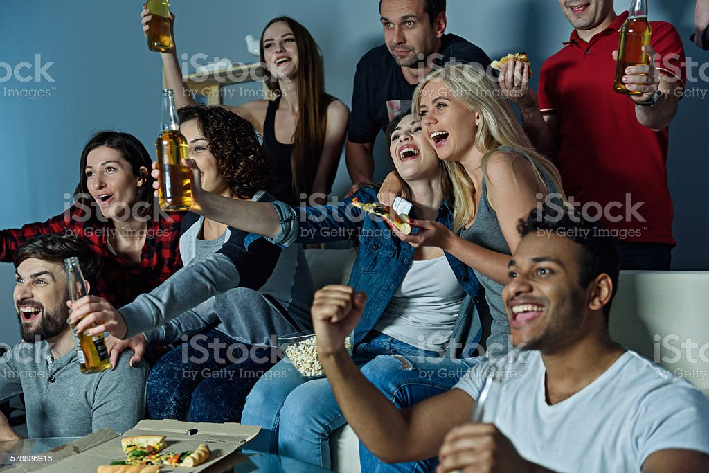 Fans of soccer watching match stock photo