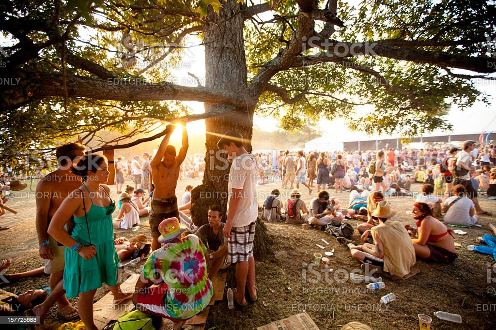 Fans relaxing at sunset during Bonnaroo Music and Arts Festival stock photo