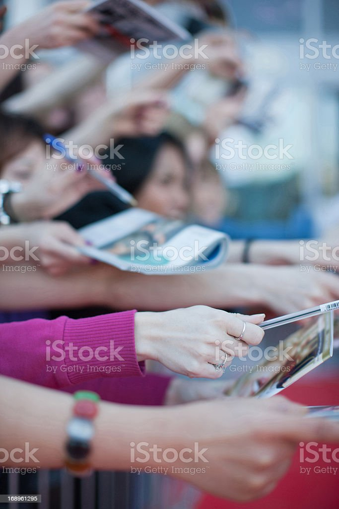 Fans trying to get autographs royalty-free stock photo