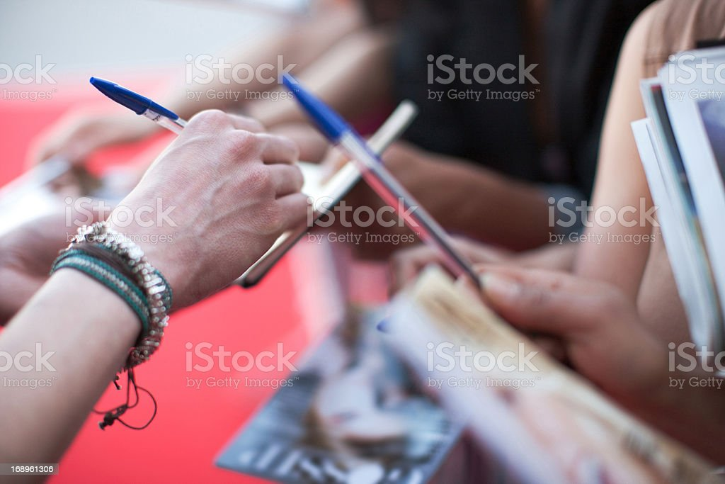 Fans trying to get autographs stock photo