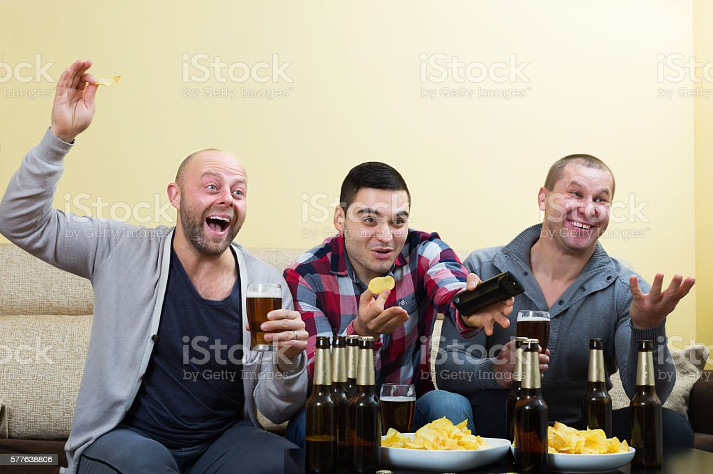 Fans watching hockey game heatedly stock photo