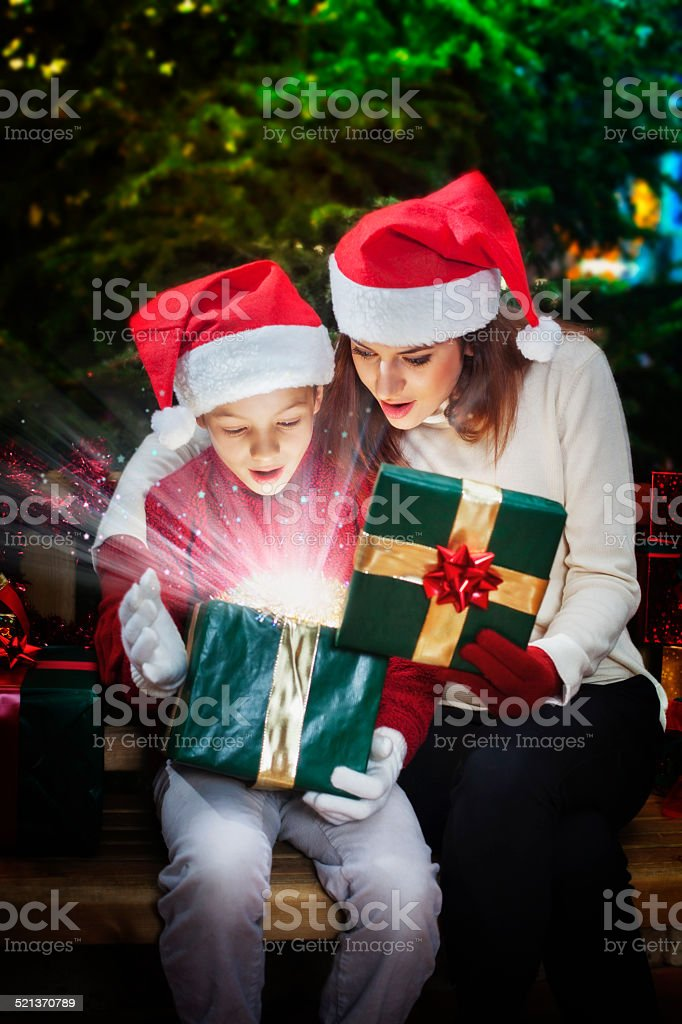 fantastic Christmas gift box with light rays and stars stock photo