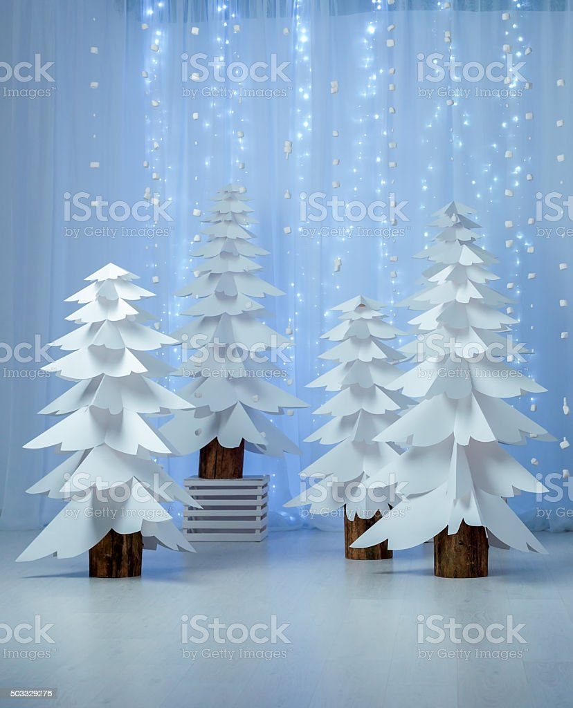 Fantastic forest of paper Christmas trees vertical stock photo