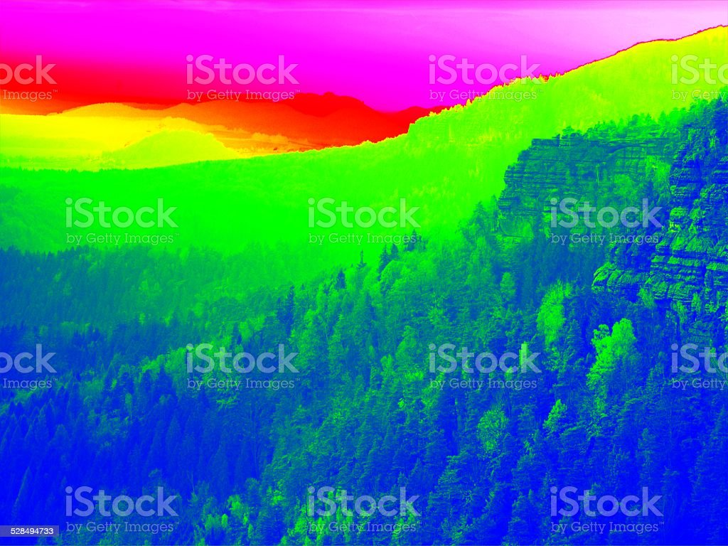 Fantastic infrared scan of rocky  landscape, forest with colorful fog stock photo