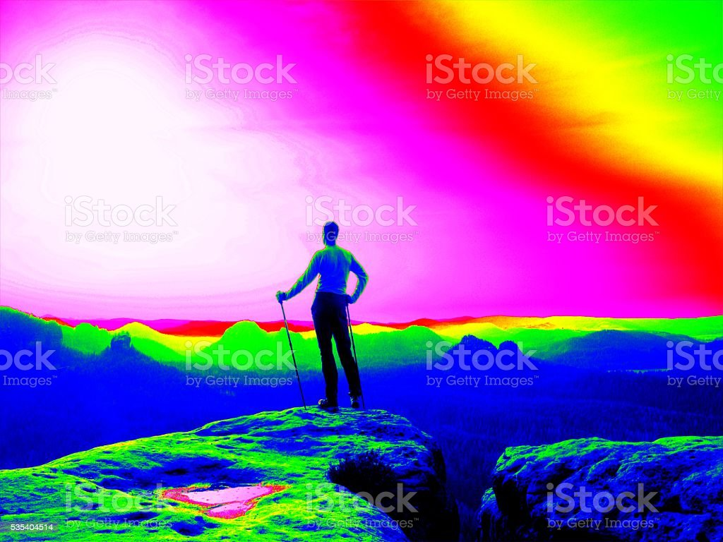 Fantastic infrared scan. Tourist with poles. Thermography colors stock photo