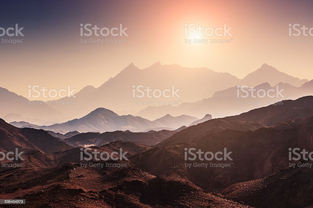 Fantastic landscape with mountains at sunset stock photo